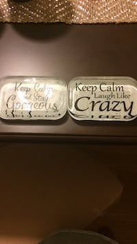 Keep calm laugh like crazy stone quote. Table decor.