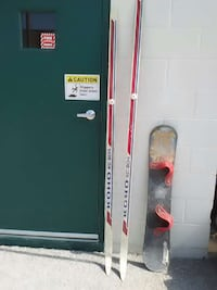 pair of red-and-white koho XC 204 ski blades and black snowboard