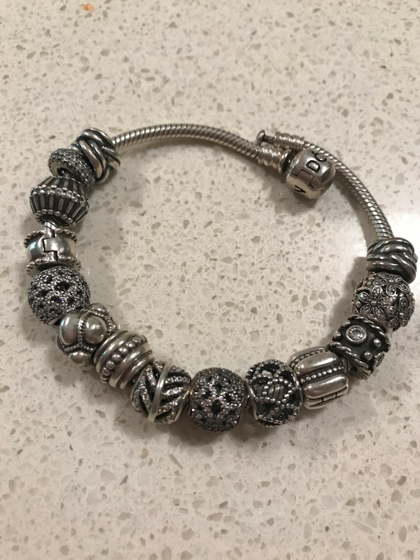 dc11e1d40 Used Sterling Silver Pandora Charm Bracelet with 14 Charms for sale in  Edmonton