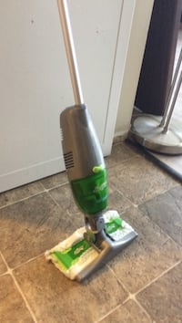 Swifter Green and black upright vacuum cleaner