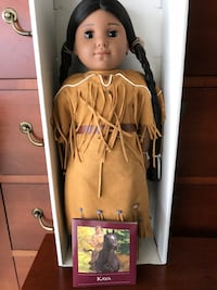 doll in brown dress with box Herndon, 20170