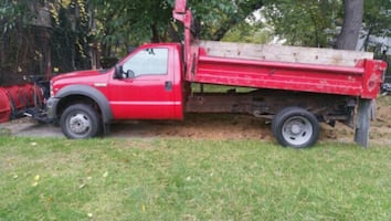 red single cab Dump truck