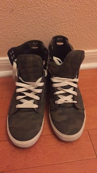pair of black-and-white high top sneakers Cibolo, 78108
