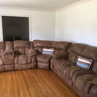 Brown leather sectional sofa with throw pillows North Charleston, 29405