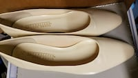 pair of beige Naturalize leather pumps