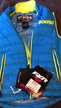 blue and green FXR vest