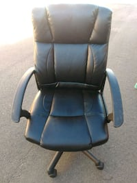 black leather padded rolling armchair 1947 mi
