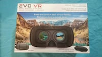 black Evo VR headset with controller box