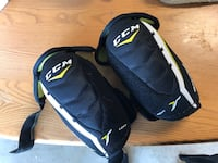 Pair of black-and-white CCM knee pads Winnipeg, R2C 3Z2