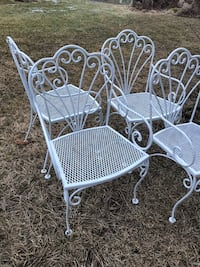 two white metal frame armchairs