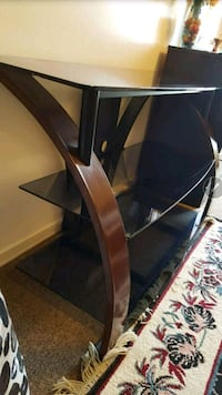 brown wooden framed glass top TV stand St. Catharines, L2M 4T6