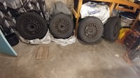 two gray bullet hole car wheels with tires London