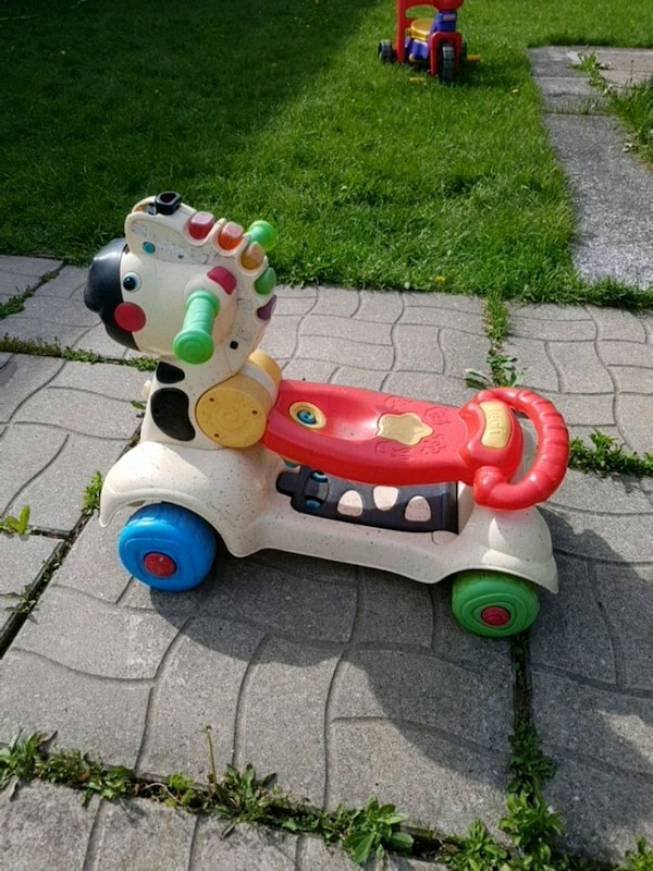 toddler's white and green ride on toy