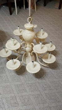 white and brown uplight chandelier