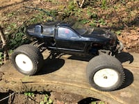 Revo Nitro RC Truck with lots of parts. Extra bodies 3 sets of  tires