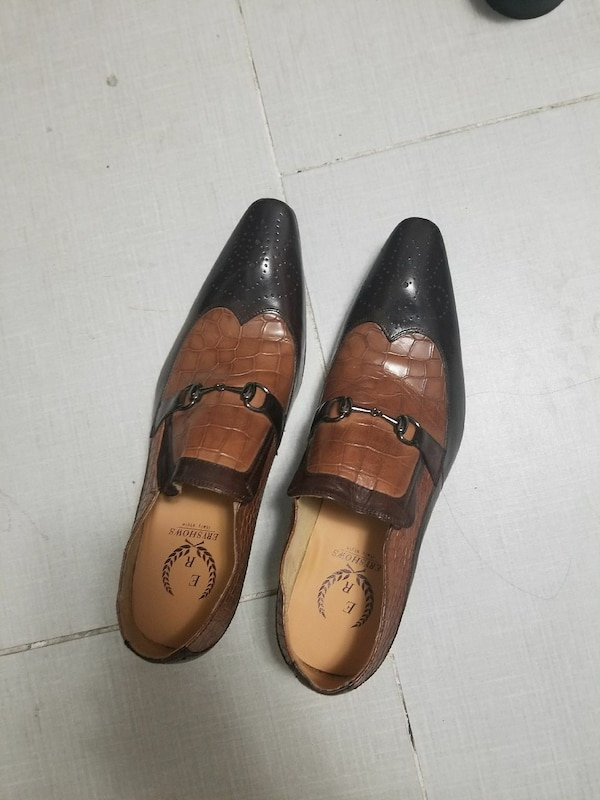 pair of brown-and-black leather dress shoes