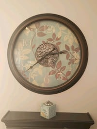 Decorative wall clock and candle holder