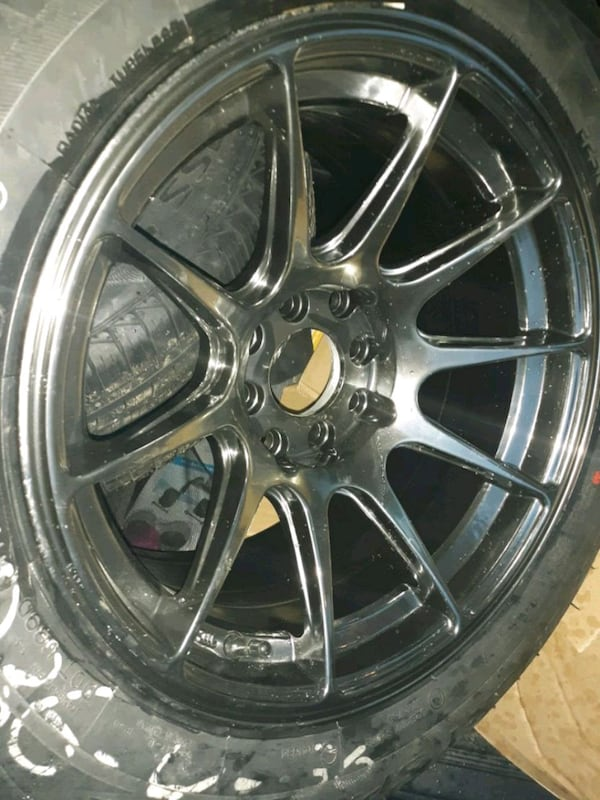 chrome multi-spoke car wheel with tire 0
