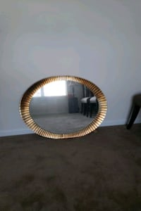 round black and brown wooden frame mirror