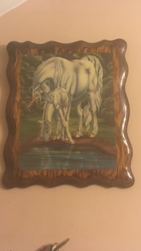 white Unicorn and pony painting with brown wooden frame