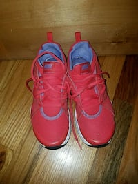 pair of red Nike basketball shoes 1621 mi
