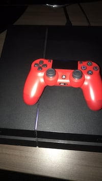 PS4 game console and red controller