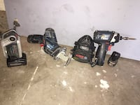 black reciprocating saw, impact driver, and battery charger 2388 mi