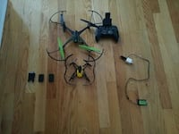 two black and yellow quadcopters with remote Laval, H7T 2A4