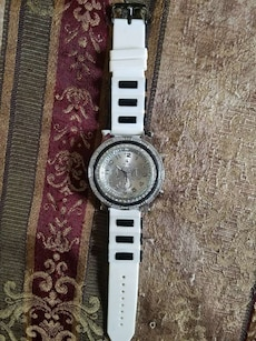 round silver chronograph watch with black and white rubber strap