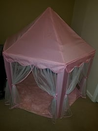 Pink tent and carpet including bear.