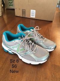 pair of teal-and-white Nike running shoes Sandy, 84070