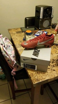 pair of red Nike soccer cleats vapor 12 elite FG Tampa, 33617