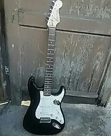 black and white strat/squire guitar