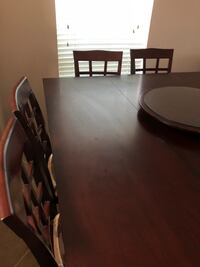 Cherrywood table, 8 chairs, and lazy Susan  Winter Garden, 34787