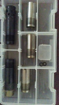five gray and black metal parts with clear plastic organizer Clover, 29710