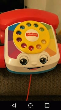 Red and white fisher-price chatter telephone