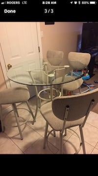 round glass top table with four chairs Hamilton, L0R 1W0