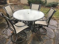 "48"" diameter tempered glass top patio table and 4 swivel rocker chairs Plymouth"