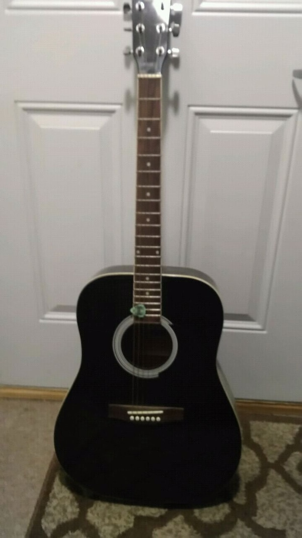 black and brown acoustic guitar