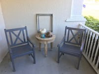 Two teak outdoor chairs