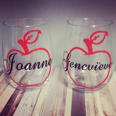 two clear glass apple print cups