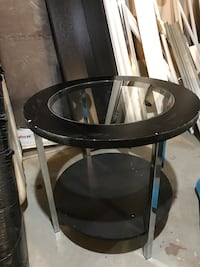 round glass top table with brown wooden base Bolton, L7E 3X6