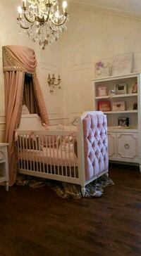 baby's white wooden crib 806 km