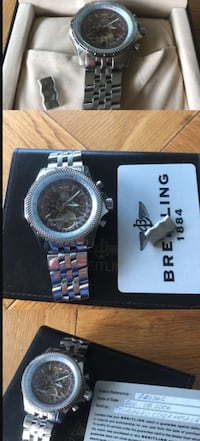 Round silver breitling watch in box