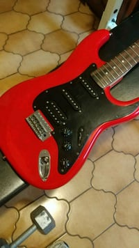 red and black electric guitar Vaughan, L4L 1G8