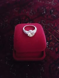 silver solitaire ring on case
