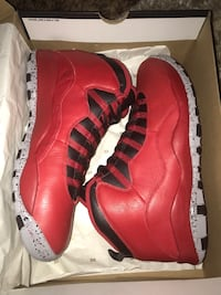 pair of red Air Jordan 10 shoes with box