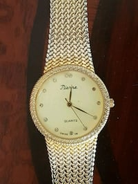 round gold-colored analog watch with link bracelet Toronto, M1C 1T8