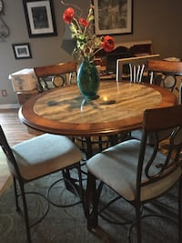 round brown wooden table with four chairs dining set Noblesville, 46062