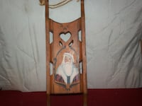 brown wooden mini sleigh with handpainted santa image Reading